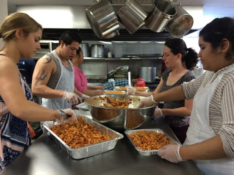 GHG members prepare meals for the less fortunate