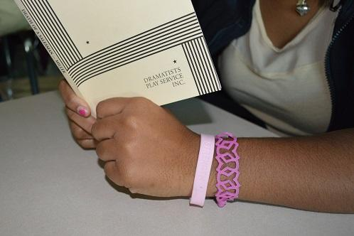 Breast Cancer Awareness bracelets are being sold by NHS member during the month of October.