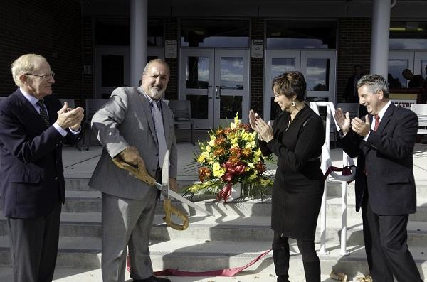 Henry+P.+Becton+Jr.%2C+Board+President+Mr.+Fred+Meo%2C+Superintendent+Mrs.+Louise+Clarke%2C+and+Business+Administrator+Mr.+Nicholas+Annitti+cut+the+ribbon+to+mark+the+official+end+of+construction.