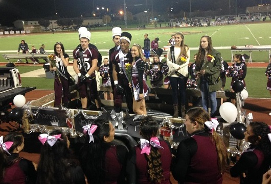 Rameen and Shannon are crowned at the Homecoming Game.