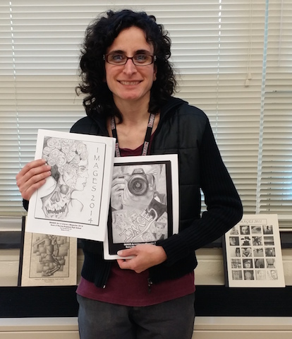 Adviser Mrs. Savincki holds up various Images magazines to display the talent of past artists.