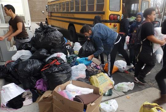 Junior David Smilowski helps fill the bus with bags of donations.