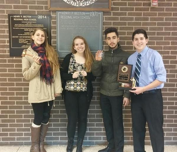 The senior debaters show off their well earned awards.
