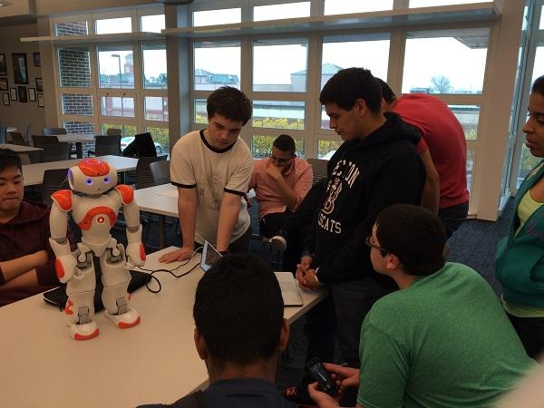 The Robotics Club members work on programming the robot to dance.