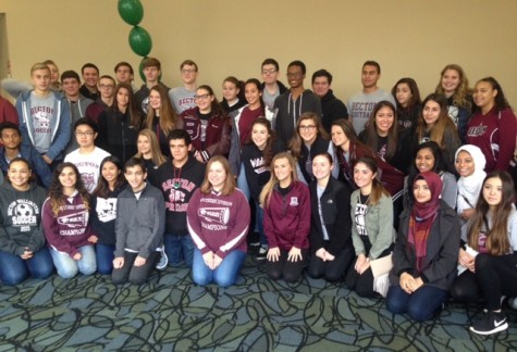 Key Club and Student Council members volunteer their time at the annual holiday party.