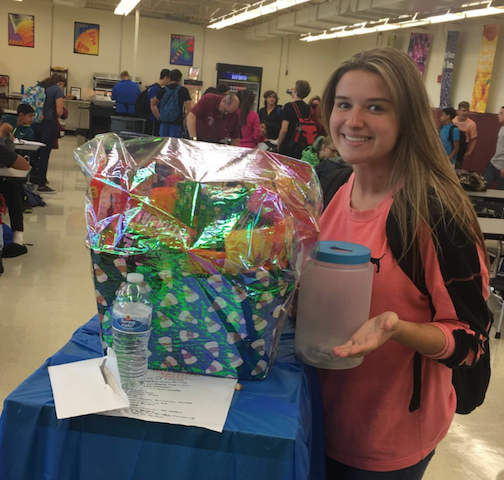 Junior Lauren Kaszka collects raffle tickets for the Halloween Basket Fundraiser.