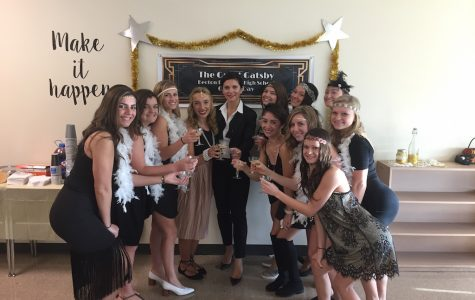 Mrs. Gatto and her students make a toast to the 1920's.