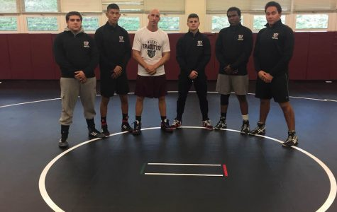 Senior members of the wrestling team and Coach Settembrino are ready for the 2016-2017 season.