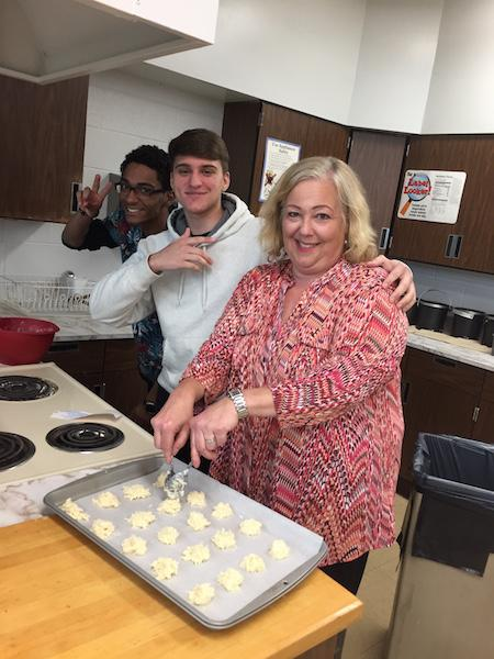 Mrs. Marut and her culinary students enjoy the art of baking.
