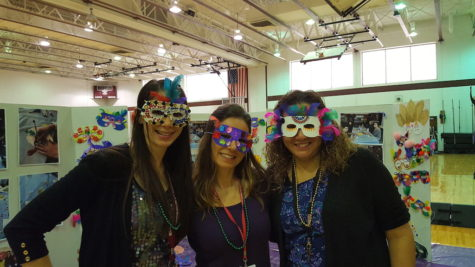 Mrs. Colangelo, Mrs. Bonanno and Mrs. Sanchez have fun wearing masks made by Becton art students.
