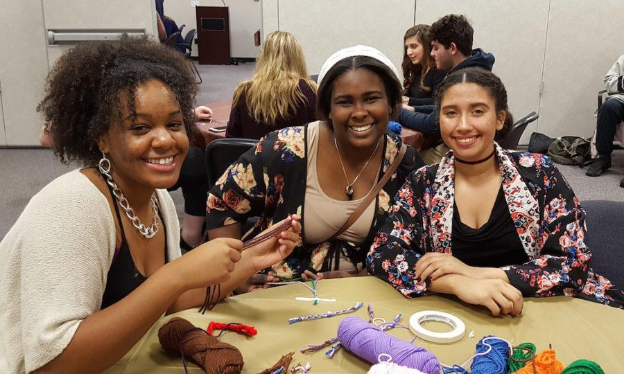 Seniors Amber Jordan, Tamia Anderson and Ashley Diaz donate their time to play with the children from Valley Hospital.