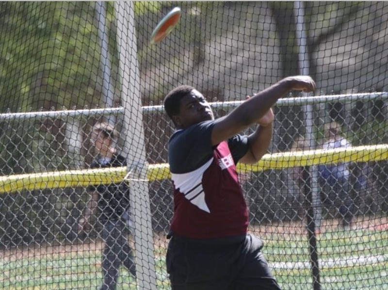 Greg beats the school record by throwing the discus 158 feet.