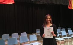 Junior Jana Christiano is inducted into the Italian Honor Society.
