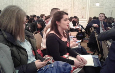 Senior Victoria Gatopoulos engages in conversation with a fellow delegate.