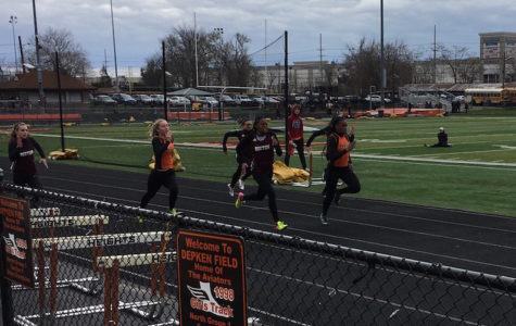 Sha-Shan-Yah Desmornes Graham, the only senior on the girls track team, is running the 200 meter against Hasbrouck Heights.