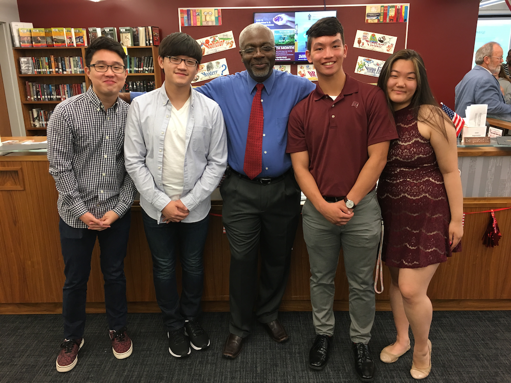 Becton students Austin Kim, Gene Lee, Timothy Reid and GaHyun Yoo all worked alongside District Technology Coordinator Mr. Gbaguidi during this school year.