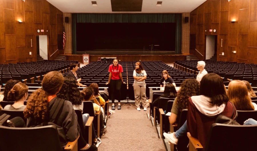 Seniors Jaylen Nuila, Amanda Roa and Lynda DeCarlo share information about what they learned while at Girls' Career Institute.