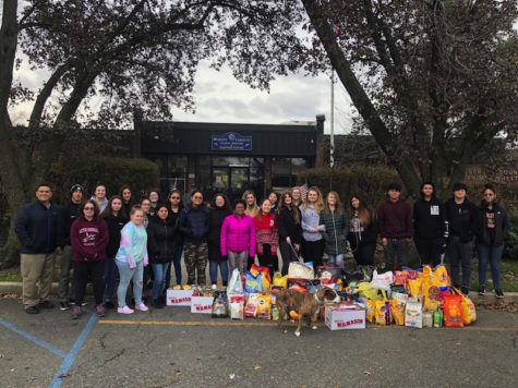 PAW Club members visit local animal shelter with numerous donations