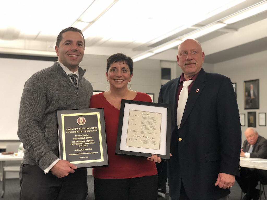 Acting Superintendent/Principal Dr. Sforza and Board President Mr. Monks present Ms. Jonna Calvanico with the Educational Services Professional Award for 2018-2019.