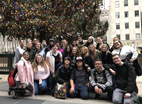 Students gather around the Rockefeller Center tree after lunch.