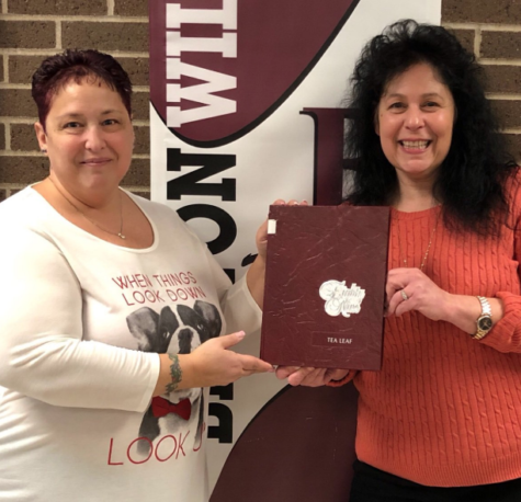 Ms. Klamerus and Mrs. Ferris hold up the 1989 Becton Tea Leaf, which is the year that they began their career at the school.