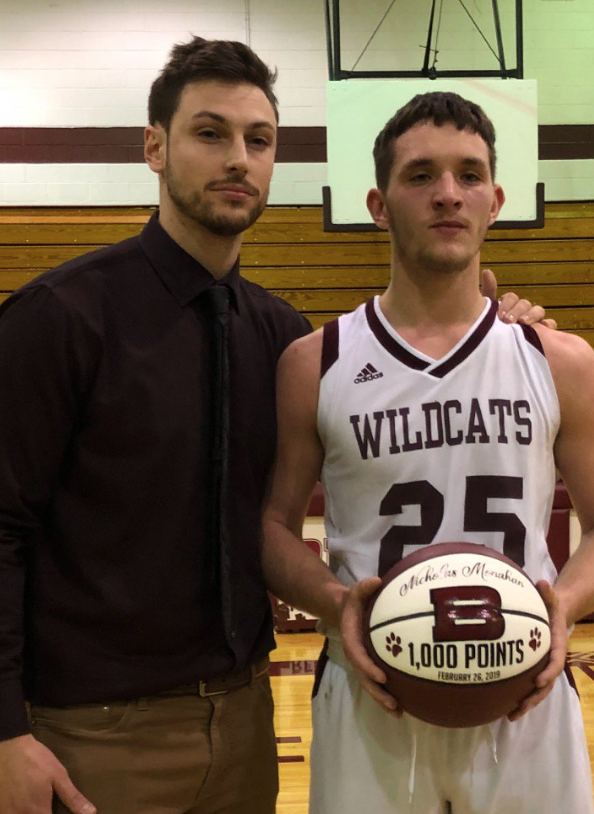 Head Varsity Basketball Coach Dan Balaban congratulates Nicholas Monahan after he nets his 1,000th point.