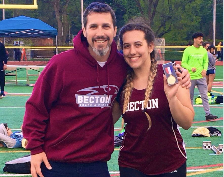 Briella Novello stands beside Assistant Coach Mr. Mendelsohn after breaking the school record and placing first in the shot put.