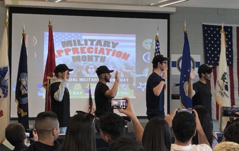 Cole Willis, Sebastian Cardona, Matthew Chattaway, and Kier Alexander repeat the Oath of Enlistment for Military Service on May 1.