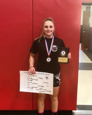 Izabella Frezzo is a champion on and off the wrestling map, as she displays her award.