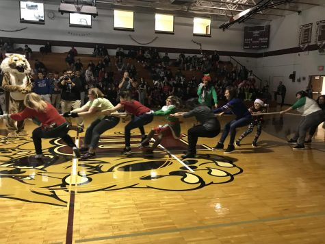 The female teacher & staff compete with the seniors in a tug-of-war.