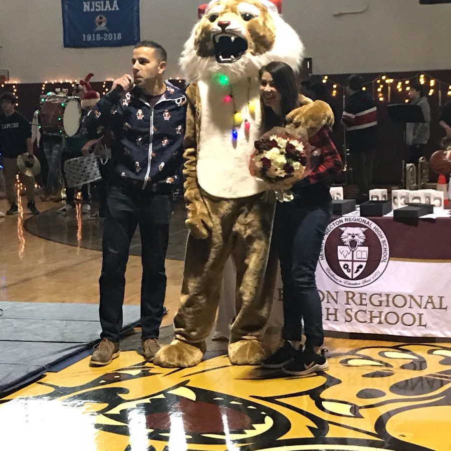 Dr. Sforza and the Wildcat Mascot award Mrs. Colangelo with Teacher of the Year!