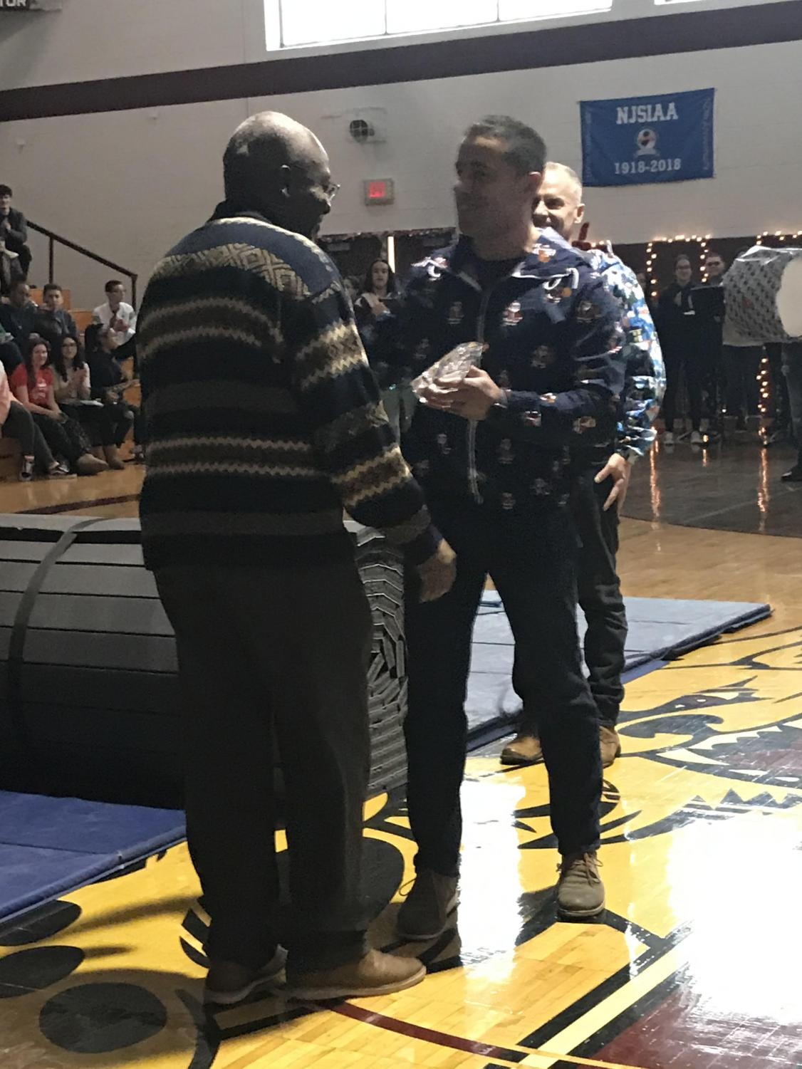 Mr. Gbaguidi is honored with the Governor's Professional of the Year award at the Winter Pep Rally