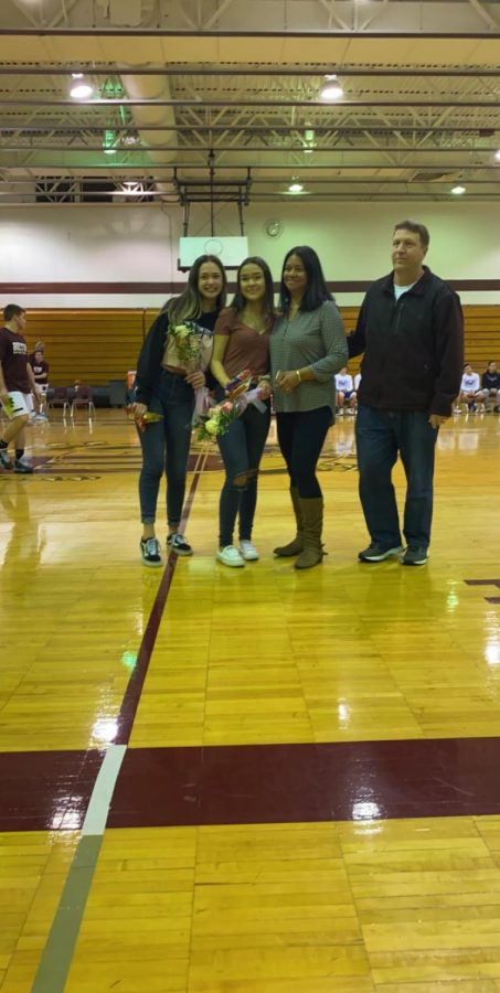 Nicolle Okumura and Kayla Lang are honored at Senior Night for keeping the stats during the 2019-20 basketball season.
