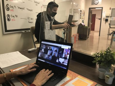 Teachers, Mrs. Lonergan and Mr. Koch, practice social-distancing while teaching students both in-person and virtually, during Phase One.