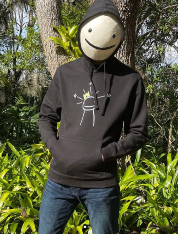 Dream wearing his new merchandise while his face is covered with his signature smiley face mask.